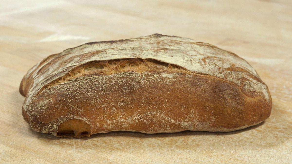 A wide, flat loaf of ciabatta