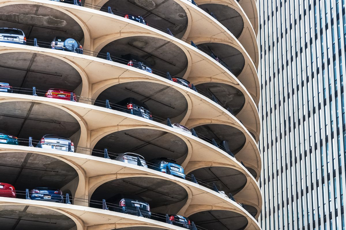 The exterior of a parking garage in Chicago. The walls are curved and each level is open.