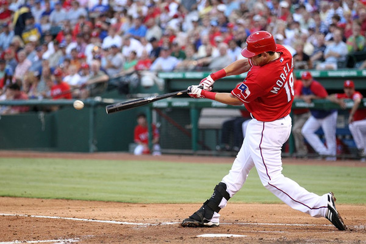 ARLINGTON TX - JULY 29:  Mitch Moreland #18 of the Texas Rangers hits a single for his first major league hit during play against the Oakland Athletics on July 29 2010 at Rangers Ballpark in Arlington Texas.  (Photo by Ronald Martinez/Getty Images)