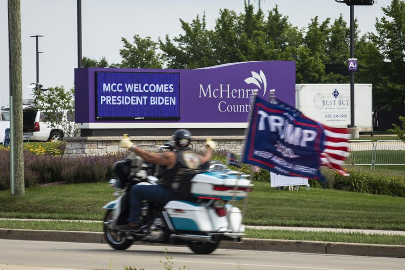 Supporters of former President Donald Trump rally outside McHenry County College in Crystal Lake on Wednesday.