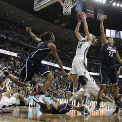 Notre Dame guard Natalie Novosel (21) shoots against Connecticut forward Kaleena Mosqueda-Lewis (23) during overtime of an NCAA women's Final Four semifinal college basketball game, in Denver, Sunday, April 1, 2012. Notre Dame won 83-75.