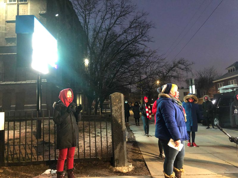Chicago teachers share concerns about reopening outside of Davis Elementary in Chicago.