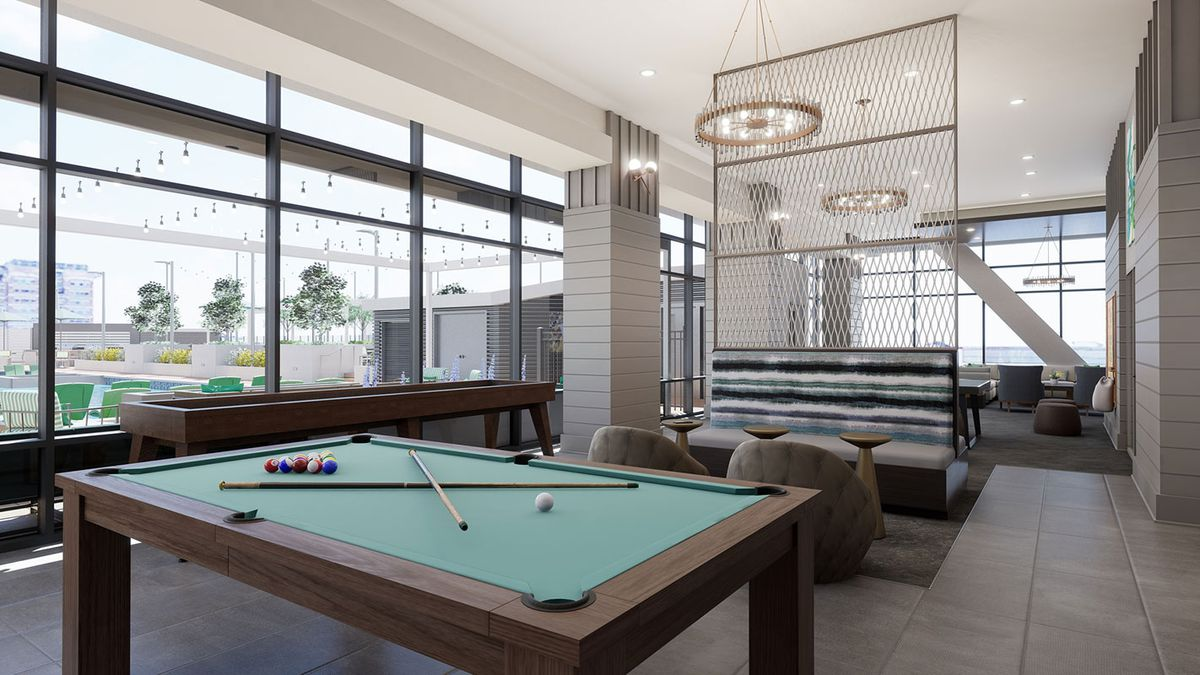 A rendering of a game room with a pool table and seating.