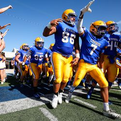 Cyprus players take the field before a high school football game against Snow Canyon at Cyprus High School in Magna on Friday, Aug. 14, 2020.