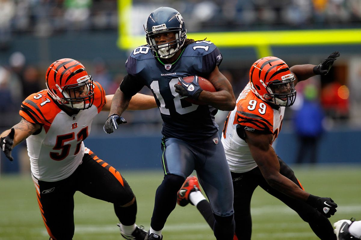 SEATTLE - OCTOBER 30:  Sidney Rice #18 of the Seattle Seahawks runs after making a catch against the Cincinnati Bengals on October 30, 2011 at Century Link Field in Seattle, Washington.  (Photo by Jonathan Ferrey/Getty Images)