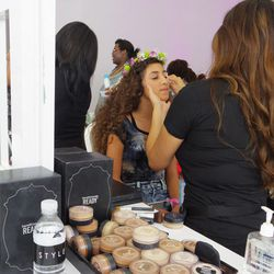 A flower-crowned guest is treated to a free makeover from BareMinerals.