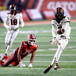 Oregon State Beavers defensive back Nahshon Wright (2) bobbles an interception after Utah Utes wide receiver Devaughn Vele (17) fell down on the play as Utah and Oregon State play a college football game at Rice Eccles stadium in Salt Lake City on Saturday, Dec. 5, 2020. Utah won 30-24.