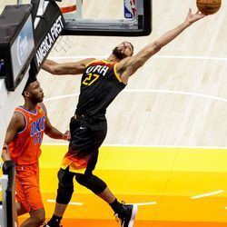 Utah Jazz center Rudy Gobert (27) stretches for a rebound during the game against the Oklahoma City Thunder at Vivint Smart Home Arena in Salt Lake City on Tuesday, April 13, 2021.