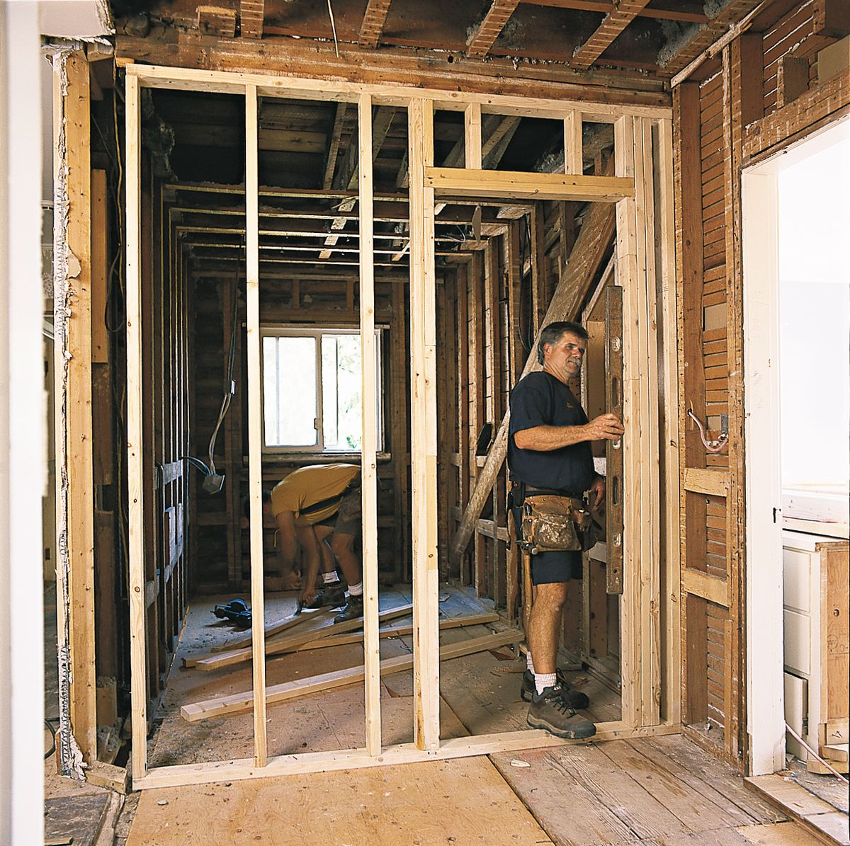 Man Checking Partition For Plumb