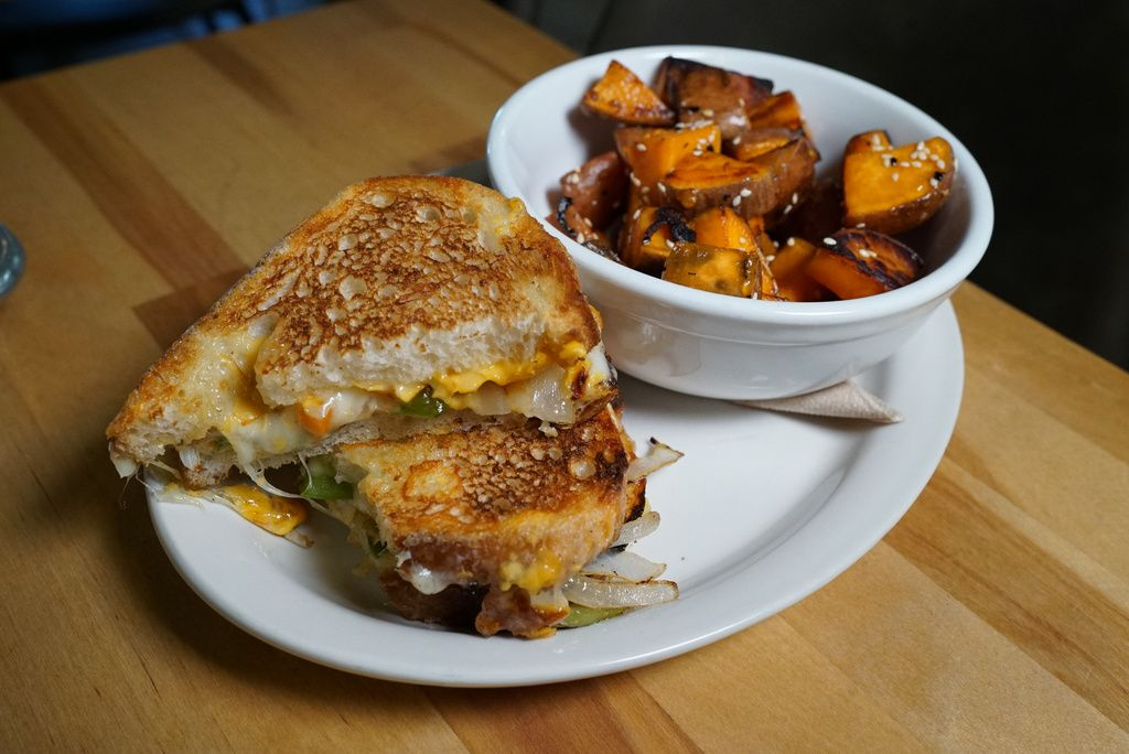 The grilled cheese sandwich and sweet potatoes served at Smack Dab restaurant.