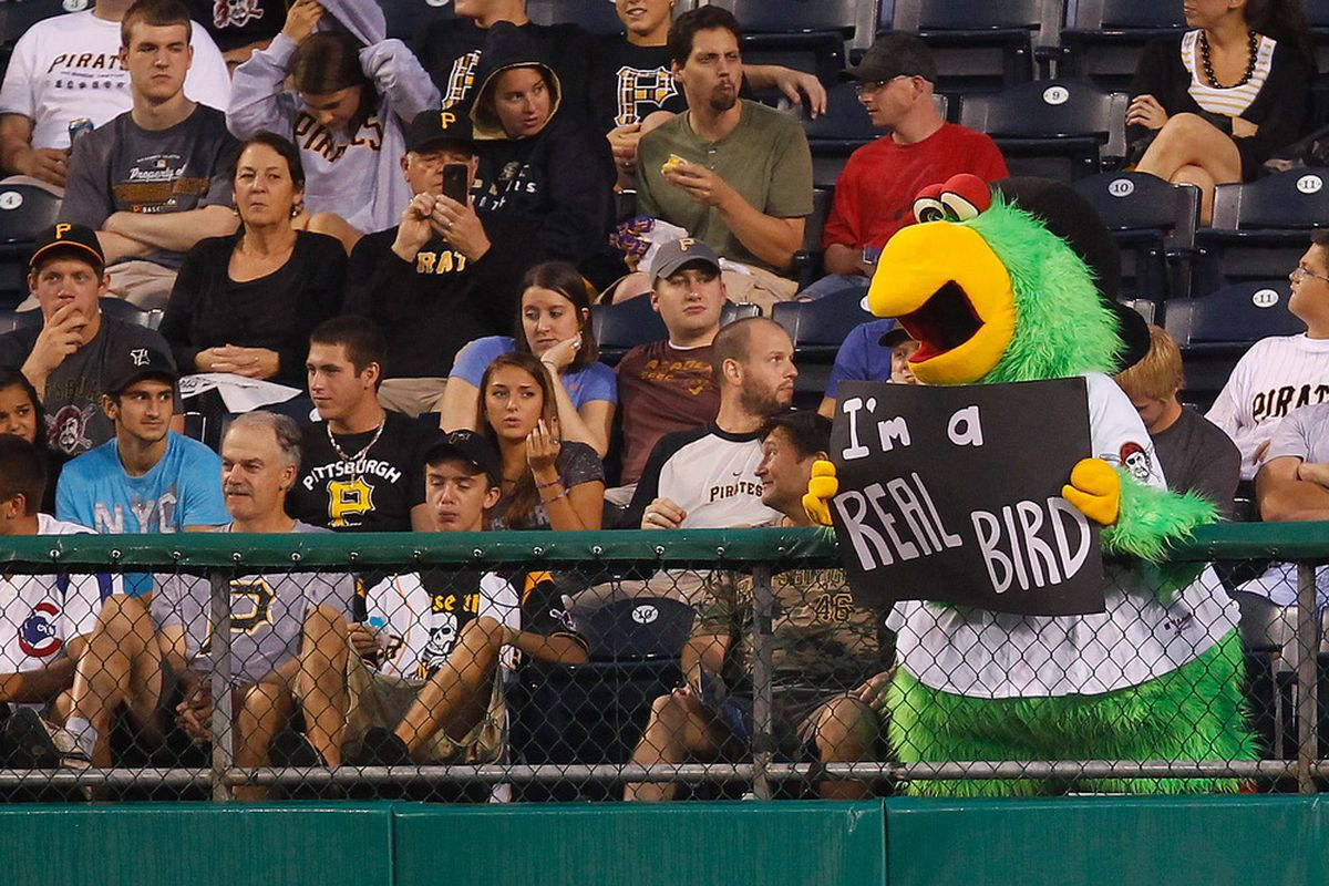 PITTSBURGH - AUGUST 03:  The Pittsburgh Pirates parrott mascot holds up a sign in the outfield during the game against the Chicago Cubs on August 3, 2011 at PNC Park in Pittsburgh, Pennsylvania.  (Photo by Jared Wickerham/Getty Images)