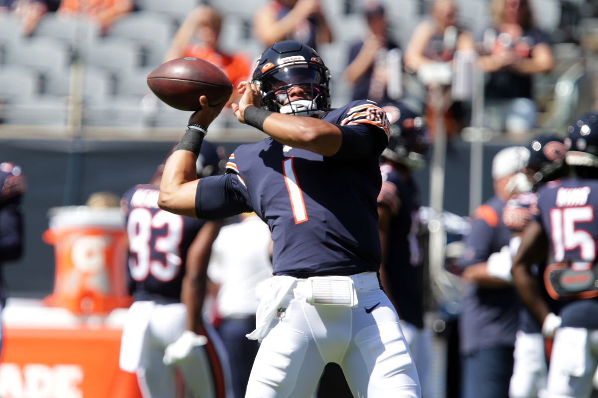 Chicago Bears quarterback Justin Fields (1) warms up before the game against a Miami Dolphins at Soldier Field.