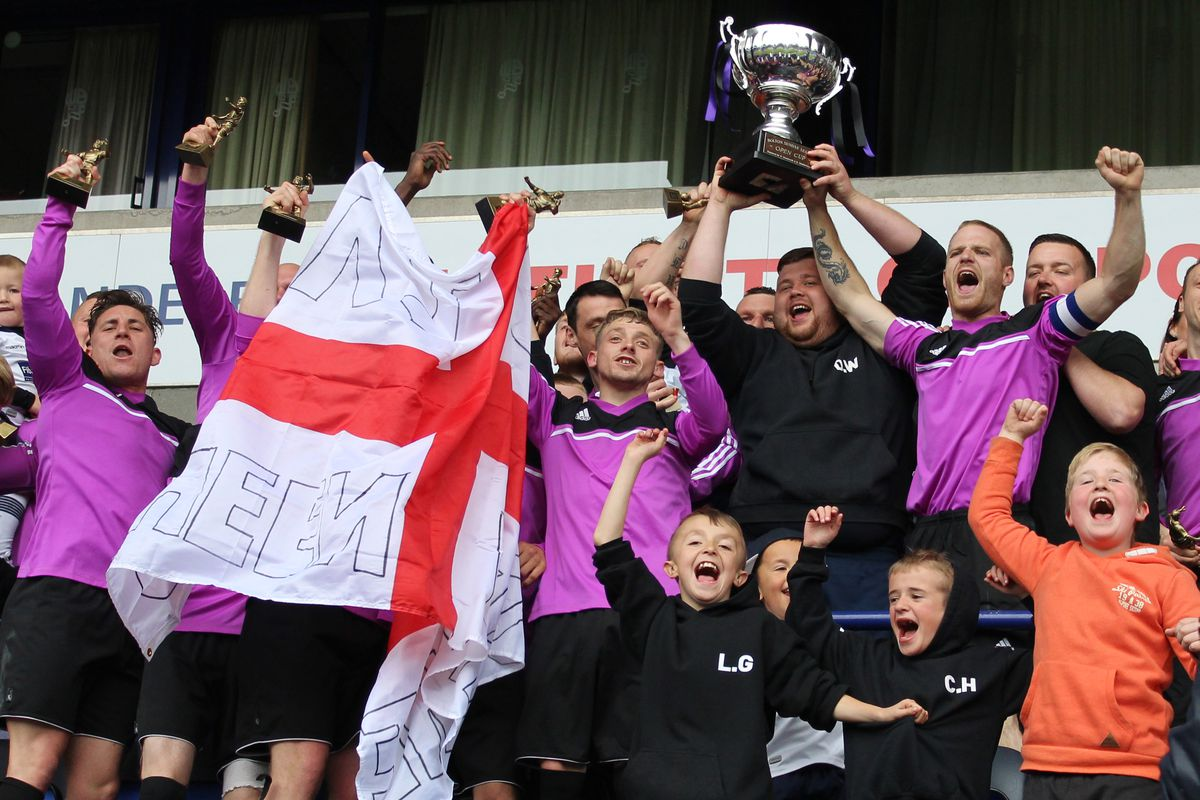 Queen Anne FC lifting the Sunday League Cup at the Macron Stadium