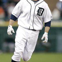 Detroit Tigers' Brandon Inge rounds third base after hitting a solo home run against the Tampa Bay Rays.