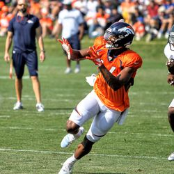 Broncos WR Courtland Sutton reaches for an incoming pass in front of Bears DB Deiondre' Hall.