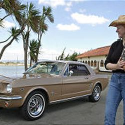Dean and Beverly Avery pose next to their 1966 Ford Mustang coupe. Most people buy vintage cars for fun.