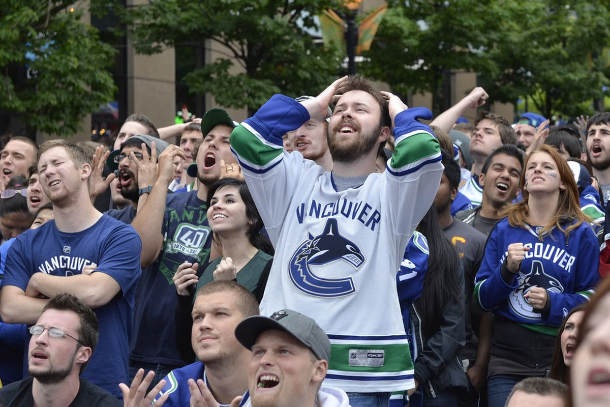 VANCOUVER, CANADA - JUNE 13: Vancouver Canucks fans react while gathered to watch Game Six of the 2011 NHL Stanley Cup Playoffs on June 13, 2011 at a viewing site in downtown Vancouver, British Columbia, Canada.  (Photo by Rich Lam/Getty Images)