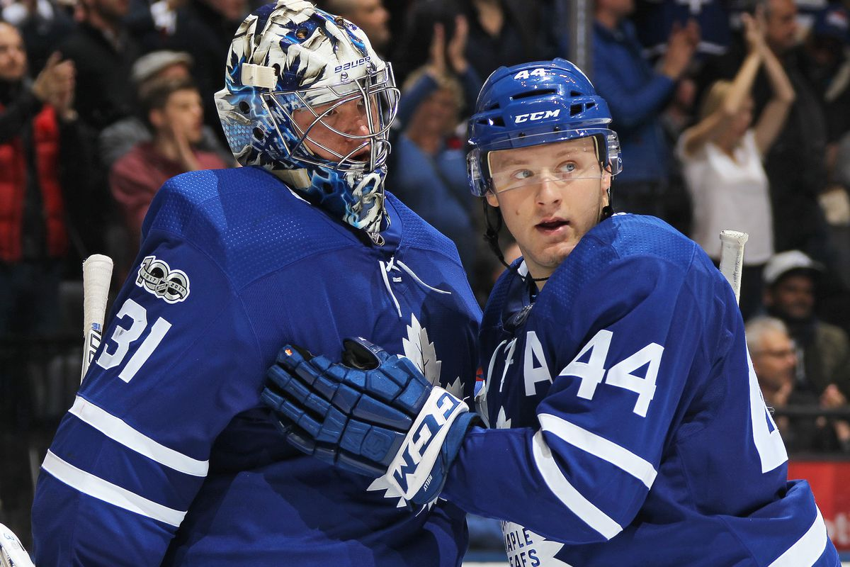 Goalie Frederik Andersen #31 of the Toronto Maple Leafs is congratulated by teammate Morgan Reilly #44 after defeating the Minnesota Wild