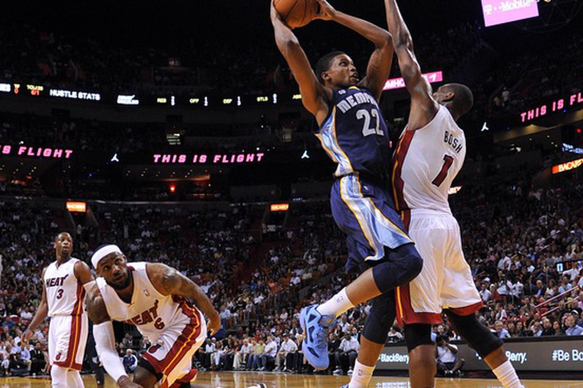 April 6, 2012; Miami, FL, USA; Memphis Grizzlies small forward Rudy Gay (22) is defended by Miami Heat power forward Chris Bosh (1) during the first half at American Airlines Arena. Mandatory Credit: Steve Mitchell-US PRESSWIRE
