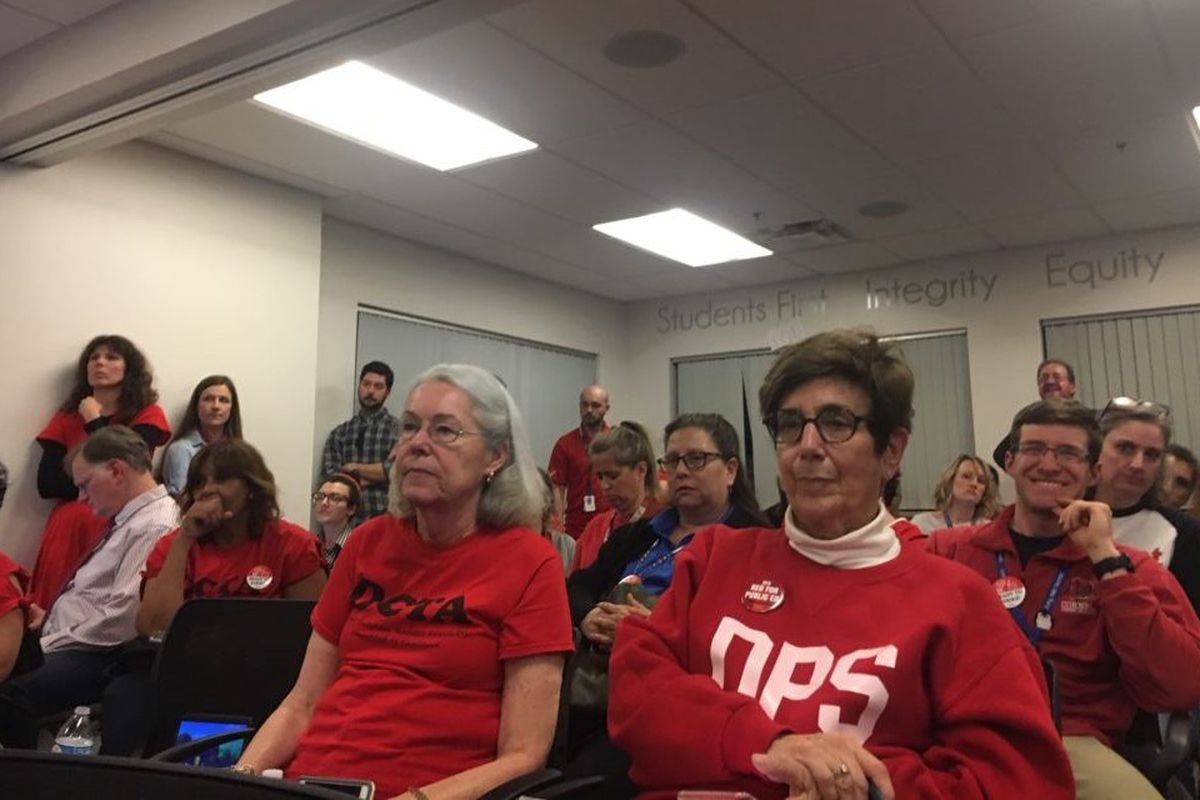 Denver teachers listen to an update on bargaining during the second to last day of negotiations before the ProComp contract expires.