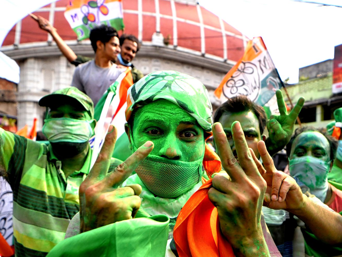 Supporters of Trinamool Congress (TMC) celebrate victory in...
