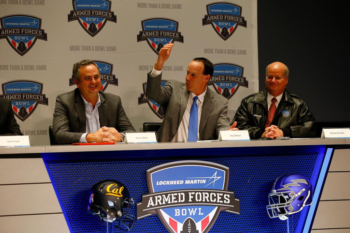 Pictured (left to right) are Sonny Dykes of Cal, Troy Calhoun of Air Force and Orlando Carvalho of Lockheed Martin