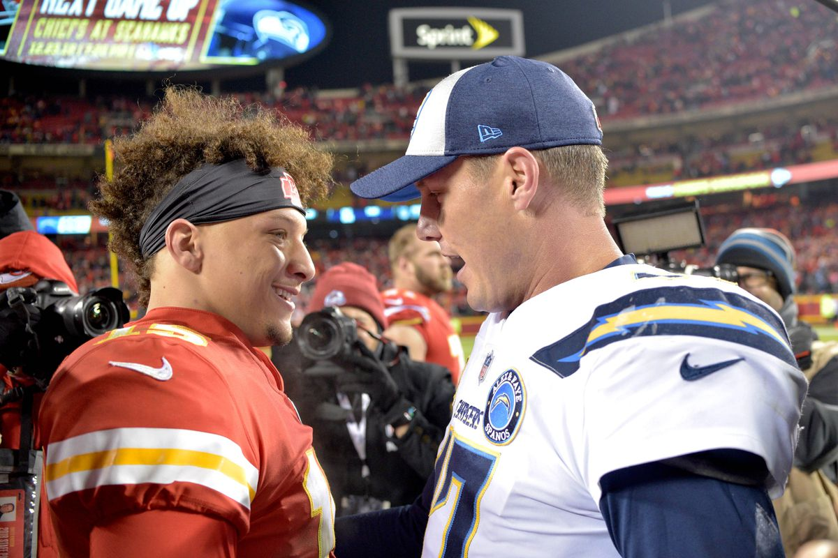 Kansas City Chiefs quarterback Patrick Mahomes talks with Los Angeles Chargers quarterback Philip Rivers after a game at Arrowhead Stadium.