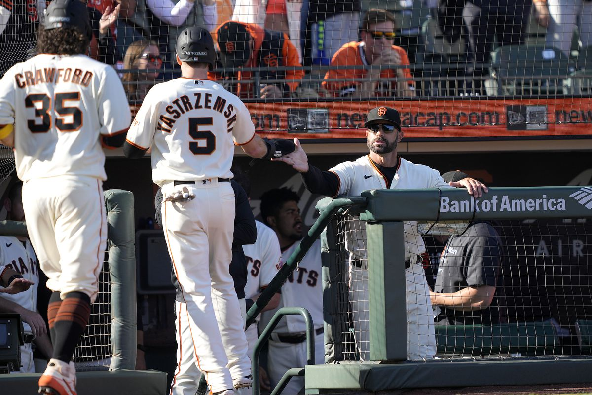 Manager Gabe Kapler #19 of the San Francisco Giants congratulates Mike Yastrzemski #5 and Brandon Crawford #35 after they scored against the Los Angeles Dodgers in the bottom of the second inning at Oracle Park on September 05, 2021 in San Francisco, California.