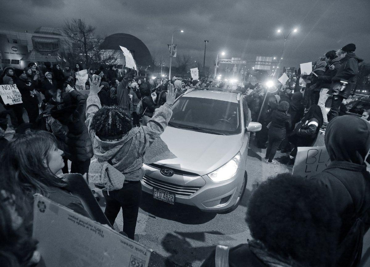 Demonstrators hold up traffic on Memorial Shoreway in Cleveland on November 25, 2014. (APImages)