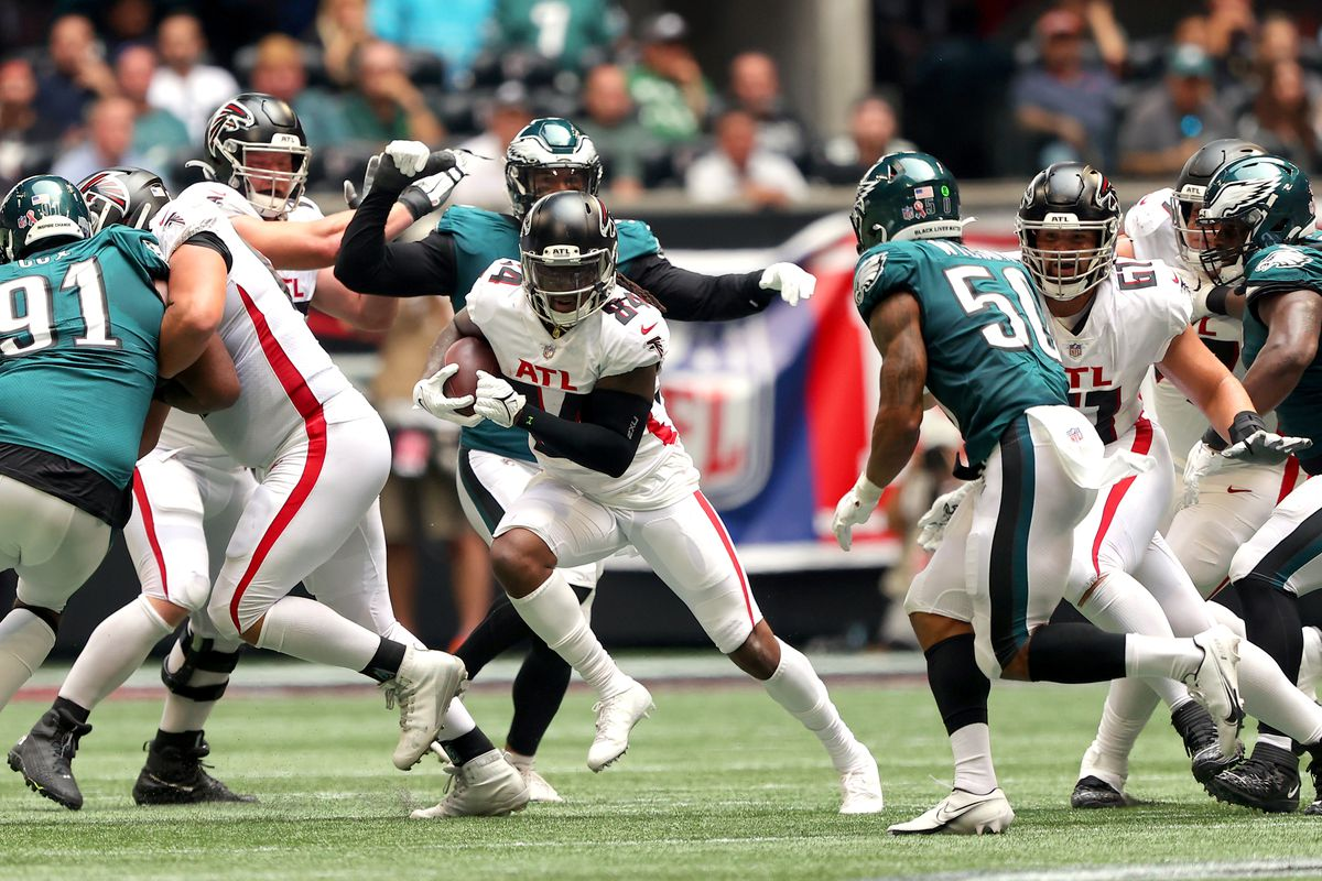 Cordarrelle Patterson #84 of the Atlanta Falcons runs with the ball after a reception against the Philadelphia Eagles during the second quarter at Mercedes-Benz Stadium on September 12, 2021 in Atlanta, Georgia.