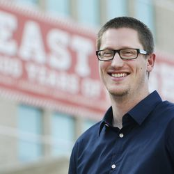 Former East High School teacher Andrew Platt poses near the school in Salt Lake City on Thursday, June 9, 2016. Platt recently resigned as a teacher and took a job with better pay, allowing him to pay off student loans.
