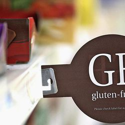 """In this Sept. 20, 2012 photo, one of several shelf tags noting gluten free products is seen in the health market section of a grocery store in Sycamore, Ill. """"Gluten free"""" has become something of a buzzword as more people are diagnosed with gluten sensitivities or celiac disease."""