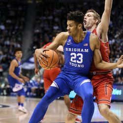 Brigham Young Cougars forward Yoeli Childs (23) spins around Utah Utes forward Chris Seeley (11) at the Marriott Center in Provo on Saturday, Dec. 16, 2017.