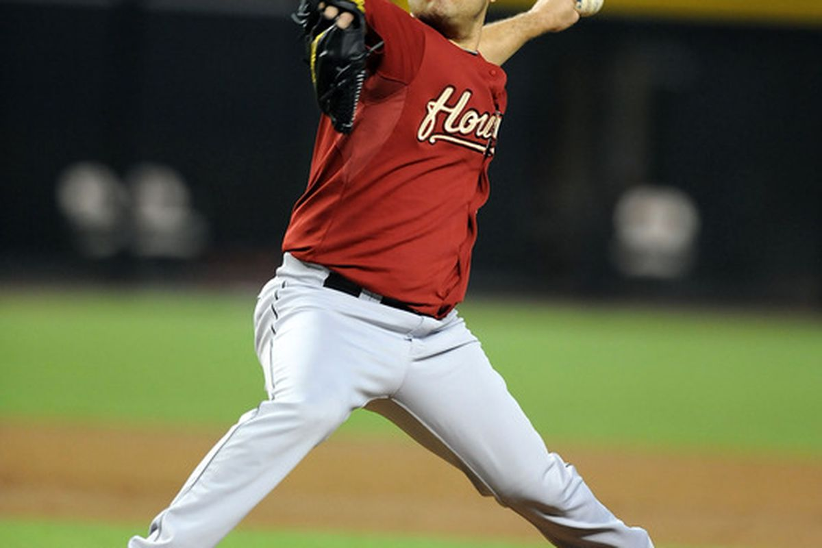 PHOENIX, AZ - AUGUST 08:  Starting pitcher Wandy Rodriguez #51 of the Houston Astros delivers a pitch against the Arizona Diamondbacks at Chase Field on August 8, 2011 in Phoenix, Arizona.  (Photo by Norm Hall/Getty Images)