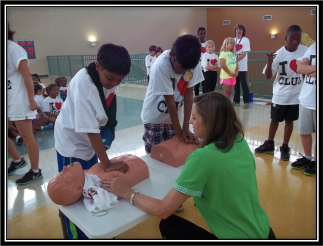Students study CPR at Shelby County Schools' CLUE camp.
