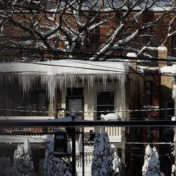 Icicles form on the roof of a building in the Edgewater neighborhood, Tuesday morning, Feb. 16, 2021, after a snowstorm dumped over a foot of snow in Chicago starting Sunday night. Snow is expected to continue to fall until Tuesday night.