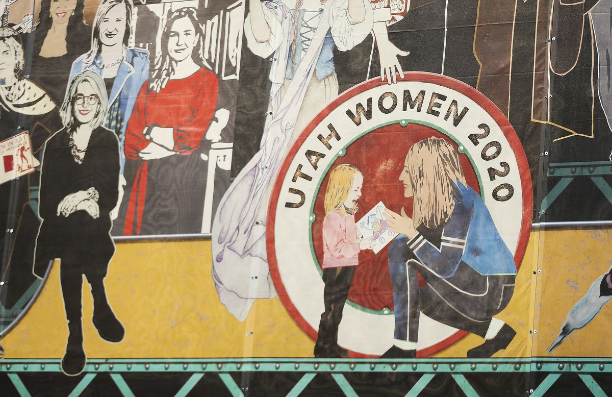 """Holly Yocom and daughter Harper are depicted in the """"Utah Women 2020"""" mural on the Dinwoodey Building in Salt Lake City, which was unveiled on Wednesday, Aug. 26, 2020. The mural, commissioned by Zions Bank in honor of women's suffrage, depicts images of 250 Utah women past and present."""