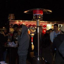 The crowd picks up dishes from the food trucks stationed at the Back of the House Brawl.