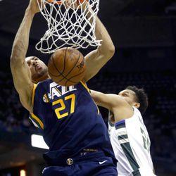 Utah Jazz's Rudy Gobert dunks against Milwaukee Bucks' Rashad Vaughn during the second half of an NBA basketball game Saturday, Dec. 9, 2017, in Milwaukee. (AP Photo/Aaron Gash)