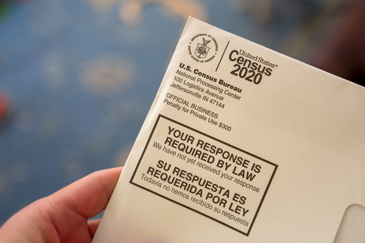 A person holds up a letter from the Census Bureau.