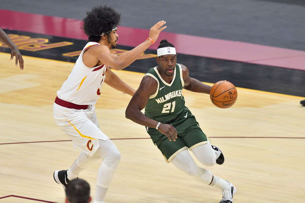 Jrue Holiday of the Milwaukee Bucks drives to the basket around Jarrett Allen of the Cleveland Cavaliers during the first half at Rocket Mortgage Fieldhouse on February 06, 2021 in Cleveland, Ohio.