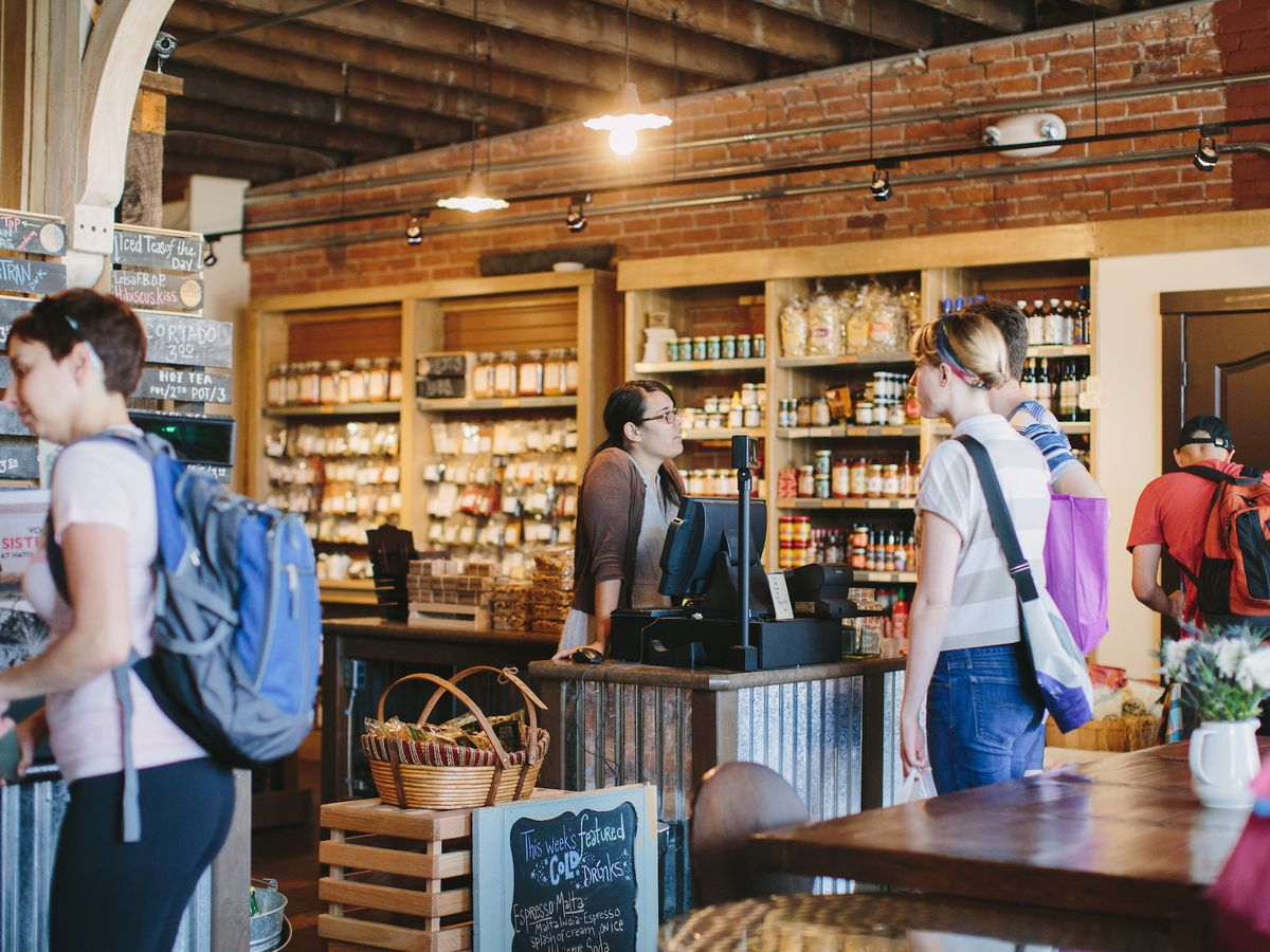 Customers with bags and backpacks wander through Germack's cafe and nut shop.