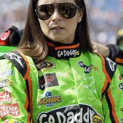 Danica Patrick listens to her crew before the NASCAR Sprint Cup Series auto race Geico 400 at Chicagoland Speedway in Joliet, Ill., Sunday, Sept. 16, 2012.