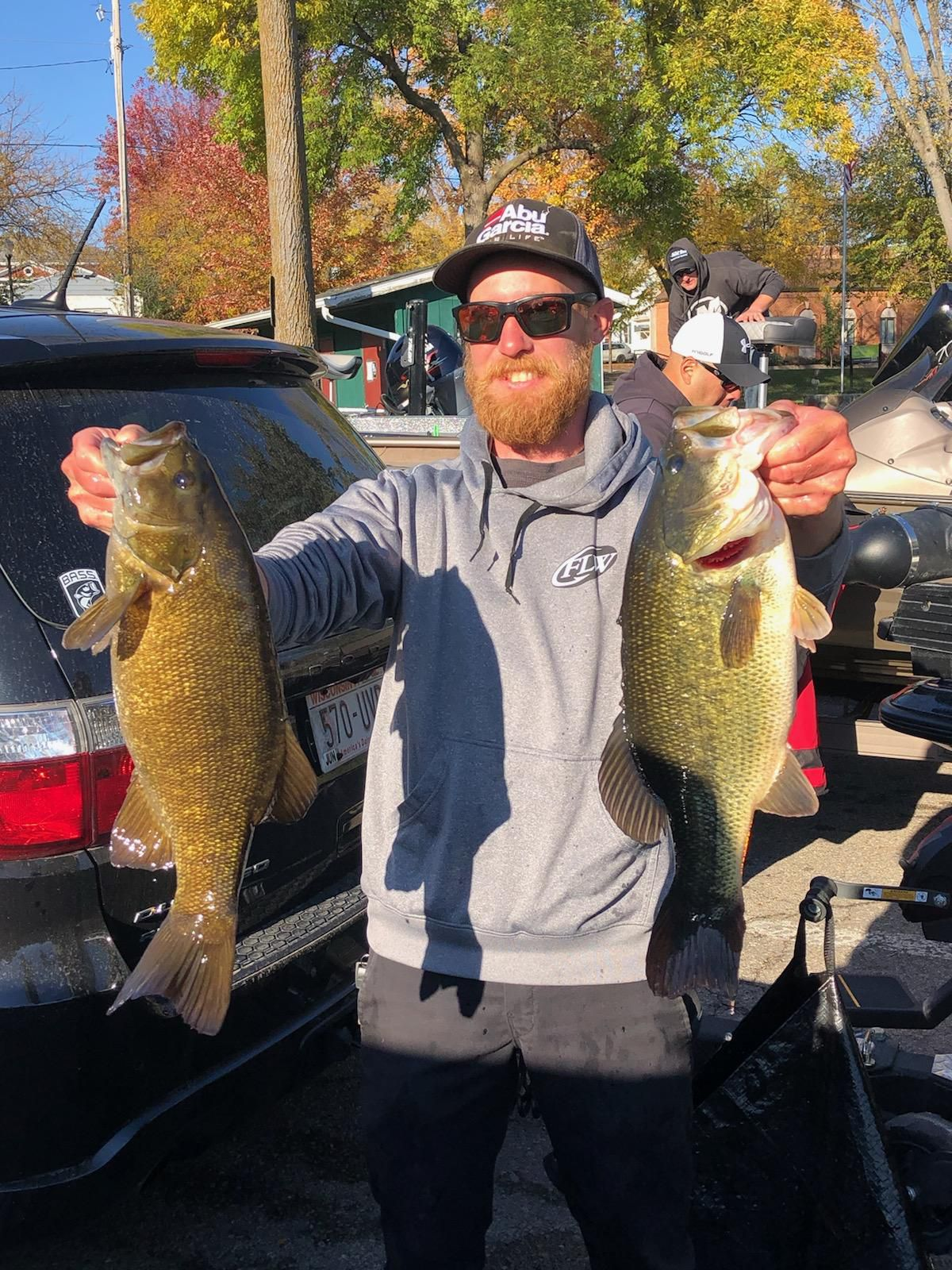 Ryan Whitaker of Chicago with two 5-pound bass caught from Big Green Lake last Sunday. Provided by Mike Norris