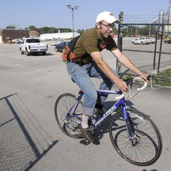 In this Aug. 30, 2012 photo, Mitch Lankford, an engineer with the city of Danville, Ill., rides his bike in Danville, Ill. The city is doing an inventory of sidewalks and bicycle facilities for the city's MOVE Danville initiative, which is an effort by the city to make Danville more bicycle and pedestrian friendly.