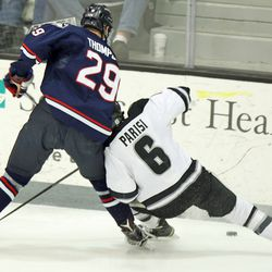 Providence's Tom Parisi (6) loses an edge as he fights with UConn's Tage Thompson (29) for the puck.