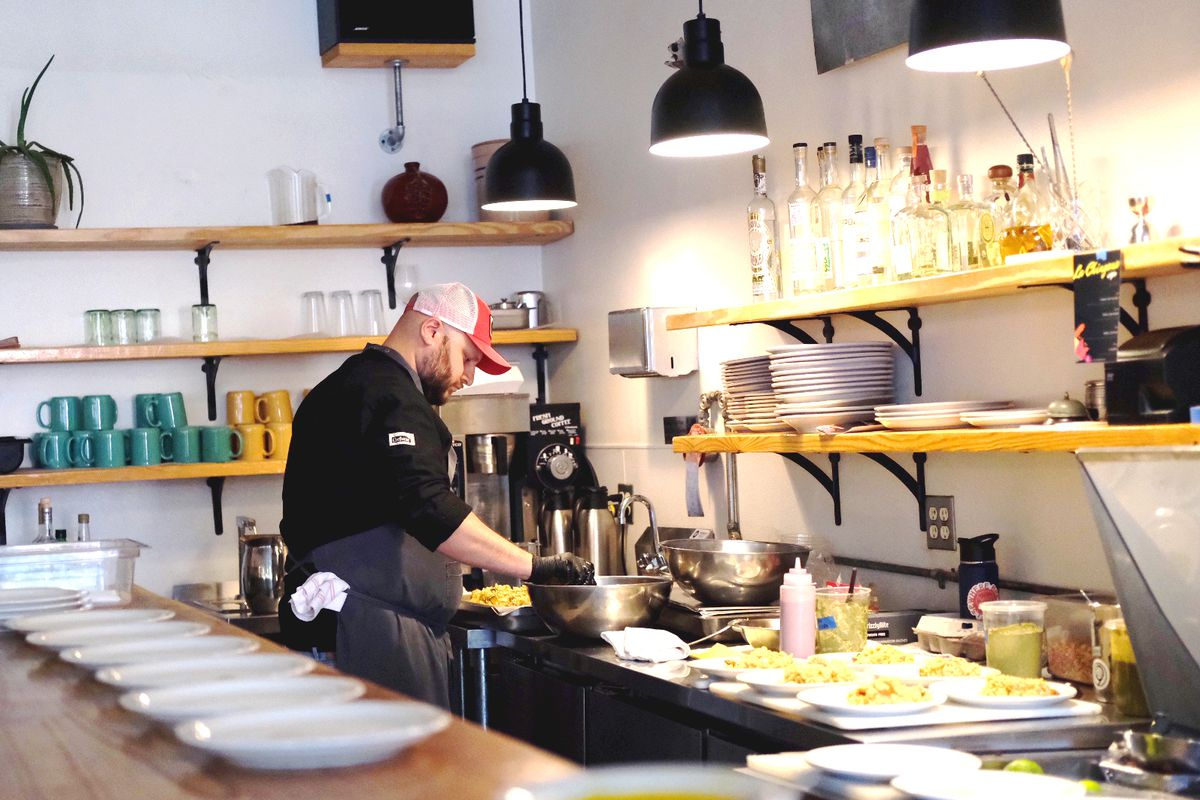 Chef Arnaldo Castillo working in the kitchen at one of his La Chingana pop-ups at Gato in Candler Park, Atlanta