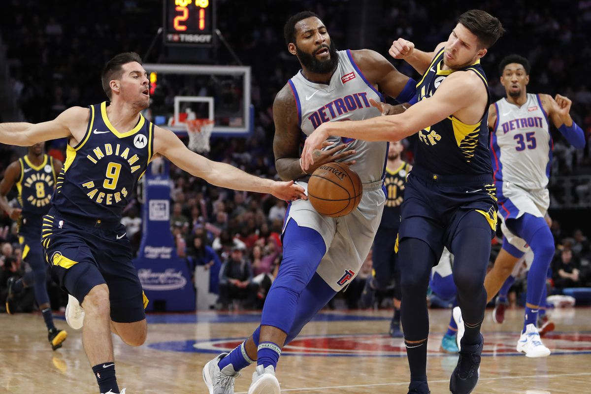 Detroit Pistons center Andre Drummond gets defended by Indiana Pacers forward Doug McDermott and guard T.J. McConnell during the fourth quarter at Little Caesars Arena.