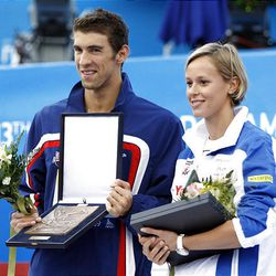 Italy's Federica Pellegrini and Michael Phelps of the United States pose after receiving a prize as the most successful individual swimmers , at the FINA Swimming World Championships in Rome, Sunday.