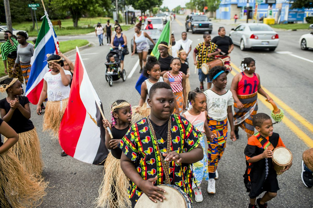 FILE - In this June 19, 2018, file photo, Zebiyan Fields, 11, at center, drums alongside more than 20 kids at the front of the Juneteenth parade in Flint, Mich. Juneteenth celebration started with the freed slaves of Galveston, Texas. Although the Emancip